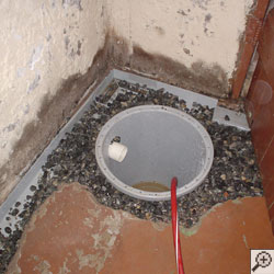 Installing a sump in a sump pump liner in a Portland home