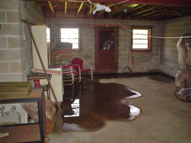 A Flooded Basement Floor In A Longview Home