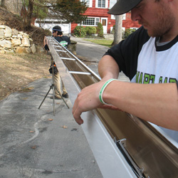 Installing gutters on a Augusta home