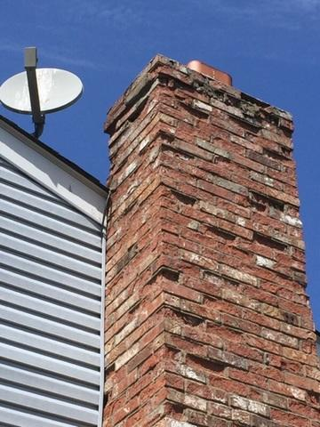 Inspecting a masonry chimney