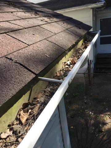Debris builds up in gutters over time and creates damaging clogs
