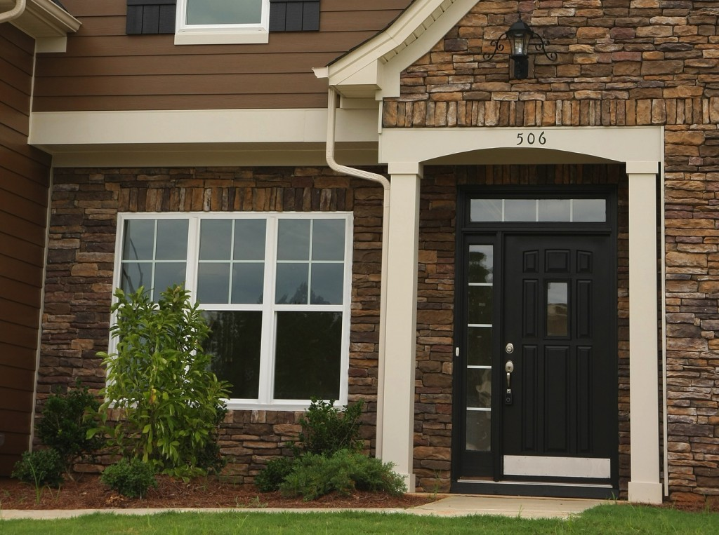 Try a contrasting front door with James Hardie commercial siding