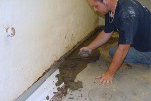 installing a wet basement repair system