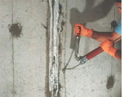 Alberta waterproofing contractor injecting urethane or polyurethane into a basement wall crack