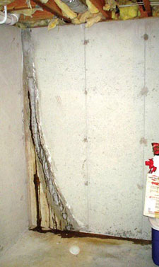 failing wall crack repair leading to new leaks in basement
