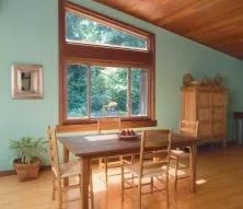 Dining room with unique angled window