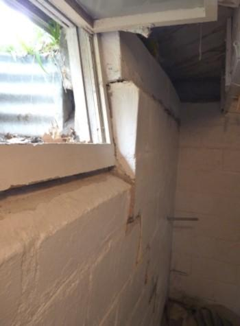 severe foundation wall failure symptoms of a basement wall