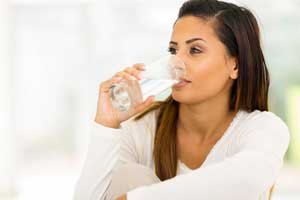 Woman drinking clean water