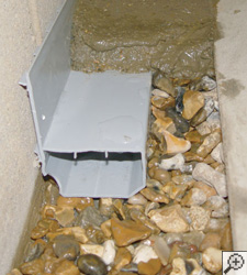 A no-clog basement french drain system