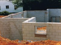 What is the Difference Between Poured Concrete and Concrete Block Foundations?
