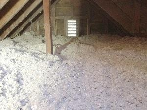 Blown-in insulation on an attic floor