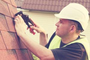 Roofer installing a roof