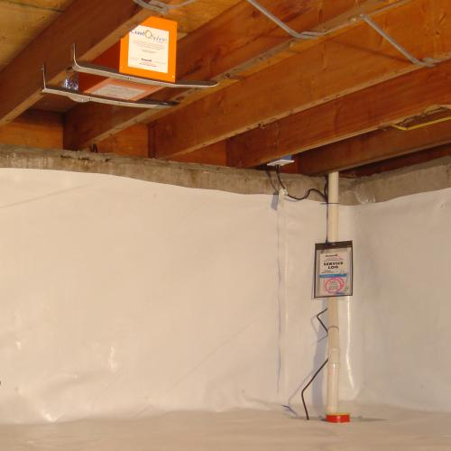 Sump pump system, dehumidifier, and crawl space wall panels installed during a sump pump installation in Dibrell