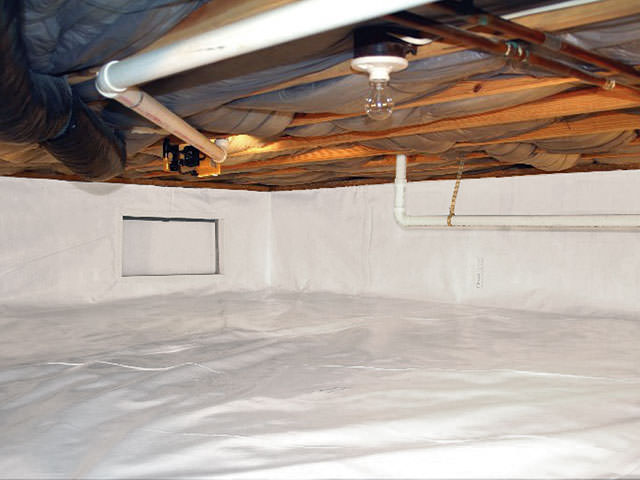 Crawl space with vapor barrier installed in Alexander, ND