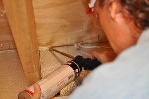 Installing SilverGlo™ foam insulation between rim joists