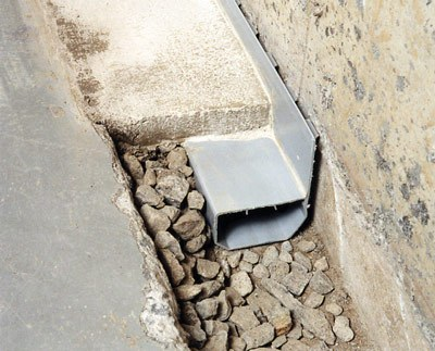 Clogged drain tile WaterGuard interior basement drain pipe & French Drain Systems vs Interior Perimeter Drainage
