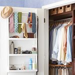 A Nicely Organized Closet With The Door Also Being Used To Create More Space