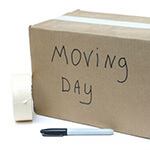 A Box With The Words Moving Day Written On It