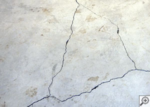cracks in a slab floor consistent with slab heave in Lone Tree