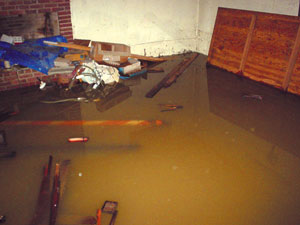 A flooded basement bedroom in Hubert