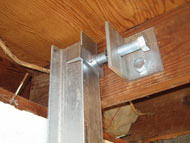 steel wall beam fastened to floor joist in Shelby, North Carolina