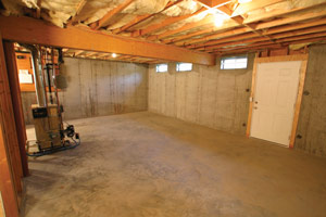 BEFORE: With multiple windows and easy egress, this basement was perfect for turning into a much needed playroom room.