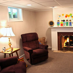 A basement living room finished with our waterproof basement system.