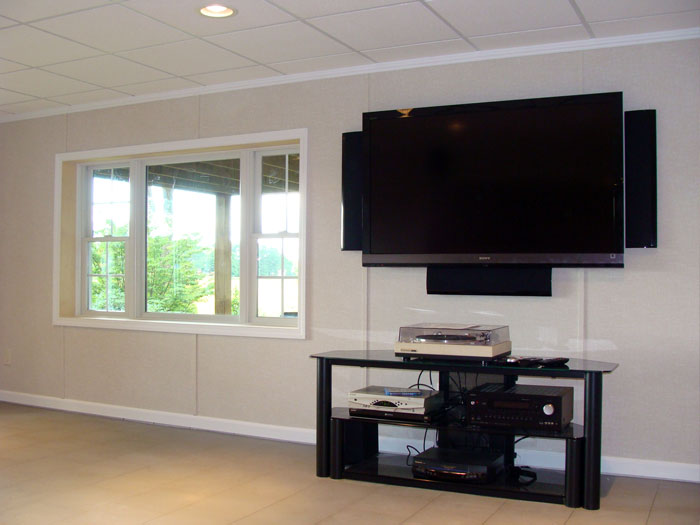 Insulated Basement Wall Panels Supporting The Weight Of A Plasma TV