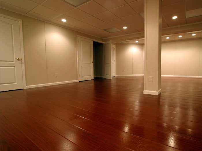 a finished basement with a wood laminate floor & Your Free Basement Finishing Quote | What To Expect From Your Free ...