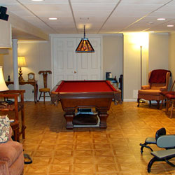 A finished basement billiards room.
