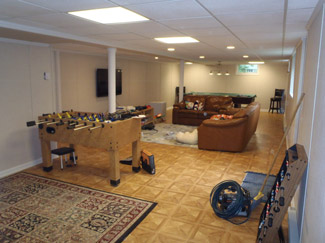 Basement game room ideas designs total basement finishing for Best flooring for basement family room