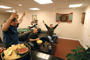 "A ""social"" man cave is a place where friends can gather for watching the big game."