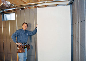 Insulated basement wall panels with metal studs.