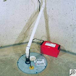 A sump pump system installed with a French drain system, airtight sump pump liner, floor drain, water alarm, and battery backup system installed.