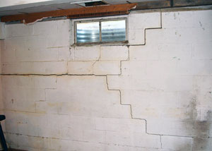 a foundation wall showing severe cracks due to expansive foundation soils