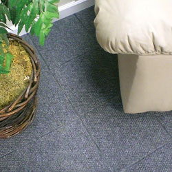 A basement carpet designed with floor tiles