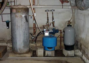 A water heater and other utilities located in a uninsulated basement.