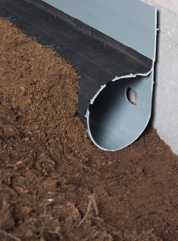 A weeping tile system for flooding dirt crawl space floors