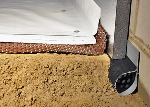 A crawl space drain, drainage matting, foam wall insulation, foam floor insulation, and a vapor barrier