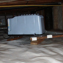 A crawl space dehumidifier system installation