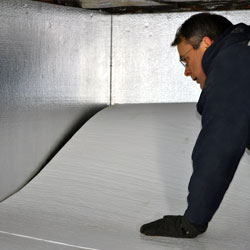 crawl space floor insulation being installed by a professional