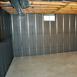 Studded insulated basement panels for prefinished concrete walls