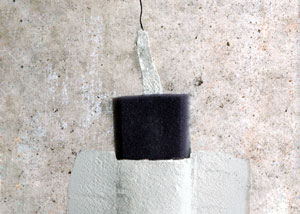 a wall crack repair system installed on a concrete basement wall