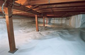 An encapsulated crawl space with a durable plastic liner installed