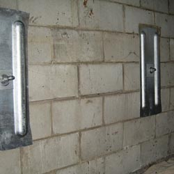a wall anchor system installed in a home with a repaired foundation wall