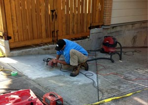 A contractor repairing and coating a concrete surface.