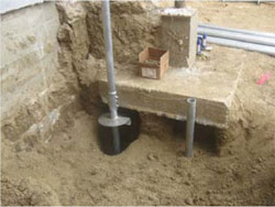 Advancing helical piers adjacent to existing column footings