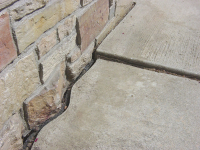Cracked, sinking sidewalk in Toronto