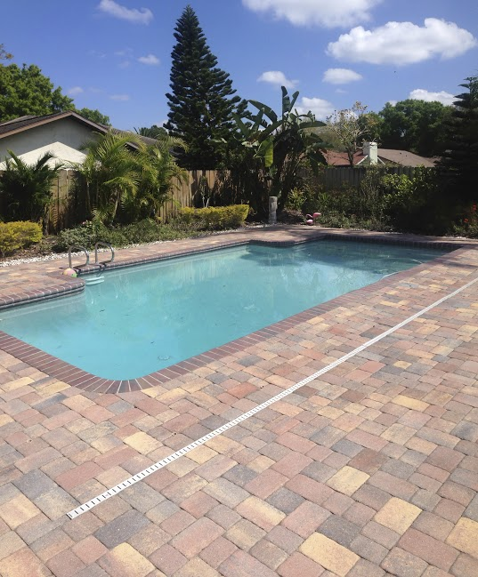 Beautiful concrete brick paver pool deck in Central Florida