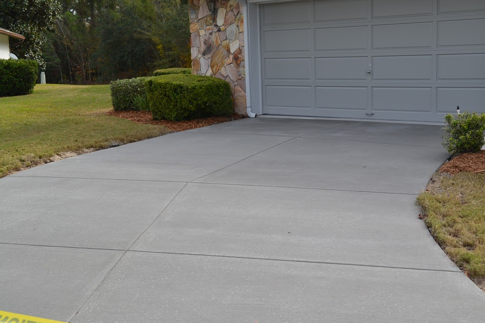 Concrete driveway restoration performed in Central Florida